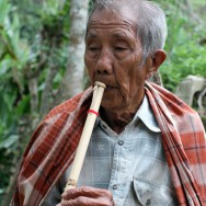 Old man playing flute, Sulawesi